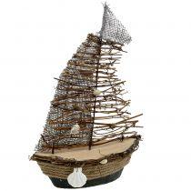 Embarcación decorativa con ramas y conchas 38cm.