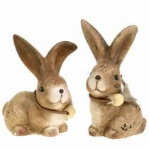 Figuras decorativas conejos con pluma y madera perla marrón surtidos 7cm x 4.9cm H 10cm 2pcs