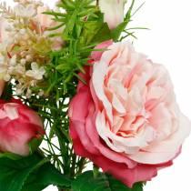 Ramo de rosas artificiales en un ramo de flores de seda rosa