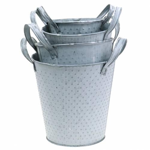 Olla de zinc con asas con puntos grises.
