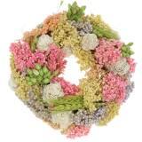 Corona decorativa de hierba seca y flores artificiales de color Ø20cm.